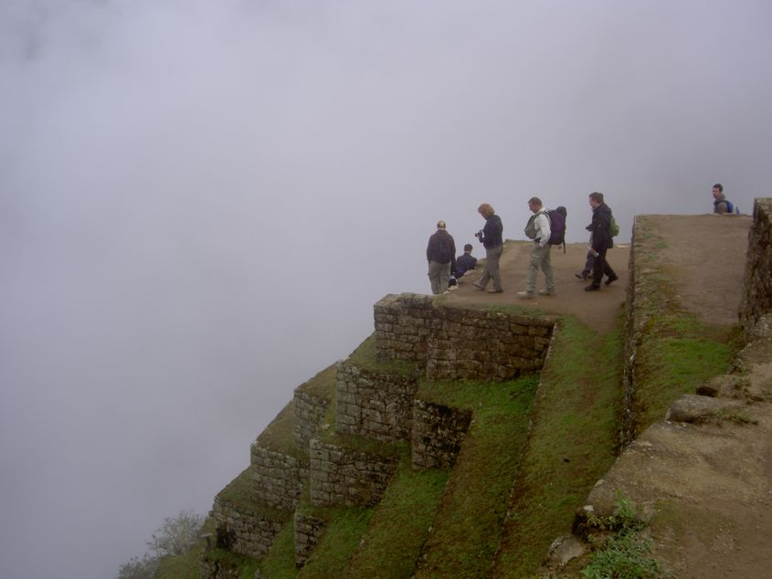 People, Machu Picchu and clouds